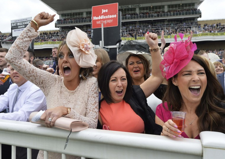 Racegoers react during racing on Ladies' Day, the second day of the Grand National horse racing meeting at Aintree, northern England. (Toby Melville/Reuters photo)