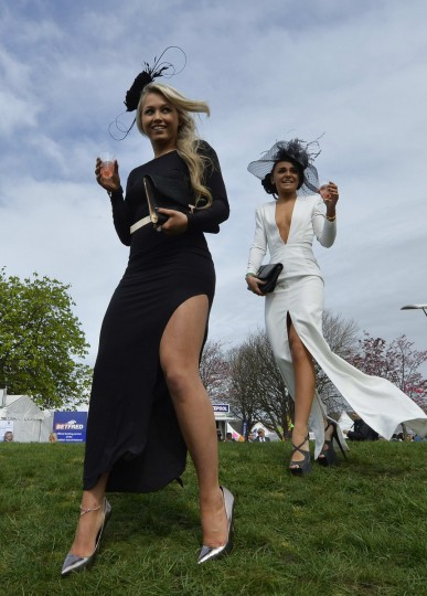 Racegoers enjoy themselves on Ladies' Day, the second day of the Grand National horse racing meeting at Aintree, northern England. (Toby Melville/Reuters photo)