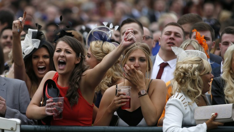 Racegoers react during the Grand National horse racing meeting at Aintree, northern England. (Russell Cheyne/Reuters photo)