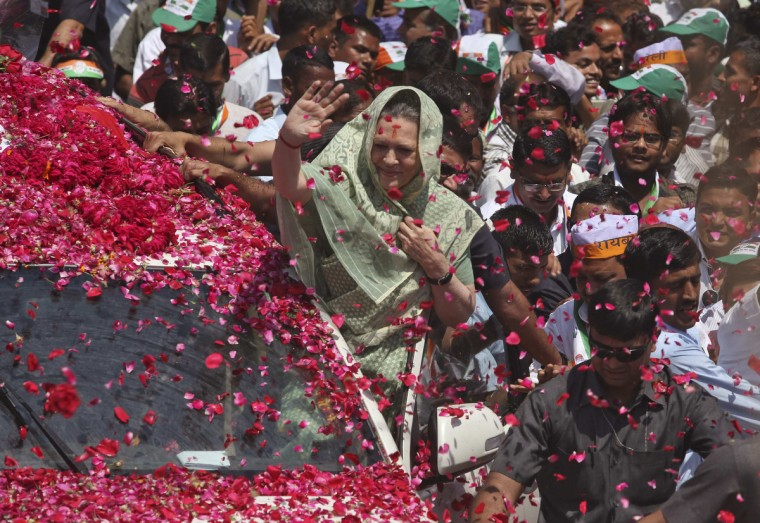 Chief of India's ruling Congress party Sonia Gandhi is showered with rose petals as she waves to her supporters upon her arrival to file her nomination for the upcoming general election at Rae Bareli in the northern Indian state of Uttar Pradesh. India, the world's largest democracy, will hold its general election in nine stages staggered between April 7 and May 12. (Pawan Kumar/Reuters)
