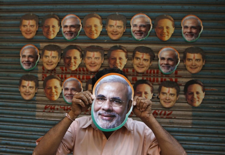 A vendor wears a mask of Hindu nationalist Narendra Modi, prime ministerial candidate for main opposition Bharatiya Janata Party (BJP) and Gujarat's chief minister, to attract customers at his stall selling masks of Indian political leaders ahead of general election in the southern Indian city of Chennai April 3, 2014. India, the world's largest democracy, will hold its general election in nine stages staggered between April 7 and May 12. (REUTERS/Babu)