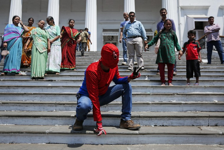Gaurav Sharma, an independent candidate also known as the Indian Spider-Man, poses as he arrives to file his nomination for the upcoming general election in Mumbai April 4, 2014. India, the world's largest democracy, will hold its general election in nine stages staggered between April 7 and May 12. || PHOTO CREDIT: DANISH SIDDIQUI - REUTERS