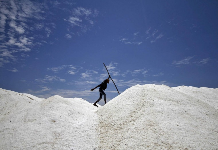 A worker walks through a salt pan on the eve of May Day or Labour Day on the outskirts of the southern Indian city of Chennai. India is the third largest salt producing country in the world after China and U.S. with global annual production about 230 million tonnes, according to government data. (Babu/Reuters photo)