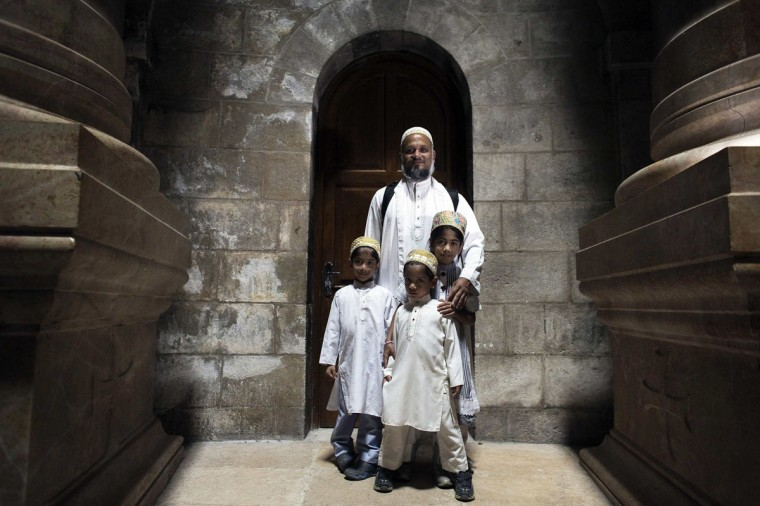 The Lovai family from India pose for a photograph in the Church of the Holy Sepulchre in Jerusalem's Old City April 7, 2014. The period around Holy Week and the upcoming Easter holiday draws pilgrims from around the globe to Jerusalem, home to some of Christianity's most important sites. Among them is the Church of the Holy Sepulchre, the most famous church in Jerusalem, if not the world, which stands on the site where many Christians believe Jesus was crucified, entombed and resurrected. Picture taken April 7, 2014. (REUTERS/Ronen Zvulun)