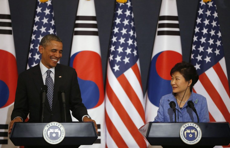 "U.S. President Barack Obama (C) reacts as he listens to questions from reporters as South Korean President Park Geun-hye watches during a joint news conference after their meeting at the presidential Blue House in Seoul April 25, 2014. North Korea represents a threat not just to Asia but to the United States, Obama said on Friday, as he and South Korea's President Park warned they would respond firmly to any ""provocations"". (REUTERS/Kim Hong-Ji)"
