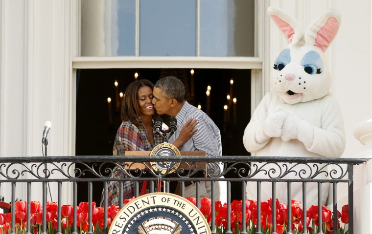 U.S. President Barack Obama kisses first lady Michelle Obama next to the Easter Bunny during the 136th annual Easter Egg Roll on the South Lawn of the White House in Washington April 21, 2014. (Kevin Lamarque/Reuters)