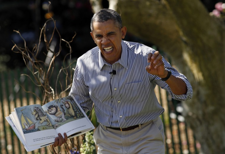 """U.S. President Barack Obama acts out the line """"gnashed their terrible teeth"""" from the children's book """"Where the Wild Things Are"""" during the 136th annual Easter Egg Roll on the South Lawn of the White House in Washington April 21, 2014. (Kevin Lamarque/Reuters)"""