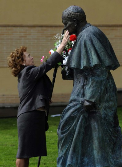 A woman touches a sculpture of Pope John Paul II in Oviedo, northern Spain April 27, 2014. Pope Francis proclaimed his predecessors John XXIII and John Paul II saints in front of more than half a million pilgrims on Sunday, hailing both as courageous men who withstood the tragedies of the 20th century. (Eloy Alonso/Reuters)