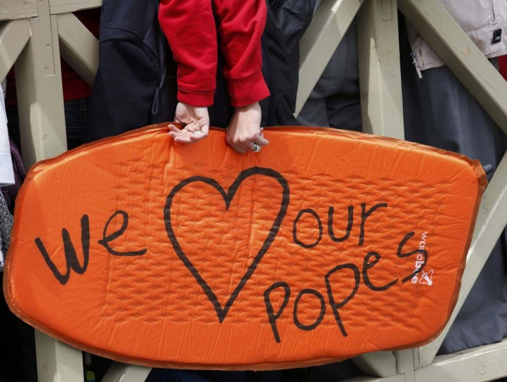 "The message ""We love our Popes"" is seen on an inflatable cushion carried in St. Peter's Square after the canonisation ceremony of Popes John XXIII and John Paul II at the Vatican April 27, 2014. Pope John XXIII, who reigned from 1958 to 1963 and called the modernising Second Vatican Council, and Pope John Paul II, who reigned for nearly 27 years before his death in 2005 and whose trips around the world made him the most visible pope in history, were declared saints by Pope Francis at an unprecedented twin canonisation on Sunday. (Giampiero Sposito/Reuters)"
