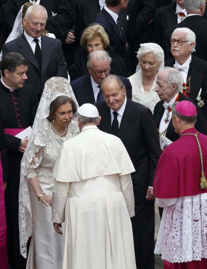 Dignitaries including Spain's King Carlos and Queen Sofia and Belgium's King Albert II and Queen Paola meet Pope Francis after the canonisation ceremony at the Vatican, April 27, 2014. Pope John XXIII, who reigned from 1958 to1963 and called the modernising Second Vatican Council, and Pope John Paul II, who reigned for nearly 27 years before his death in 2005 and whose trips around the world made him the most visible pope in history, were declared saints by Pope Francis at an unprecedented twin canonisation on Sunday. (Alessandro Bianchi/Reuters)