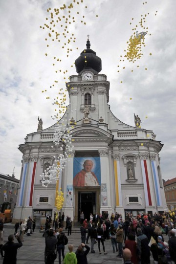 Yellow and white balloons are released as Catholic faithful celebrate the canonisation of Pope John XXIII and John Paul II in the hometown of Karol Wojtyla, who later become Pope John Paul II, in Wadowice April 27, 2014. Pope Francis proclaimed his predecessors John XXIII and John Paul II saints on Sunday, hailing both as courageous men who withstood the tragedies of the 20th century. (Michal Lepecki/Agencja Gazeta)