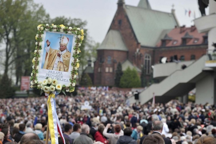 Pilgrims celebrate the canonisation of Pope John Paul II near the Sanctuary of Divine Mercy in Krakow April 27, 2014. Pope Francis proclaimed his predecessors John XXIII and John Paul II saints on Sunday in front of hundreds of thousands of pilgrims celebrating two 20th century giants of the Roman Catholic Church. (Filip Klimaszewski/Reuters)