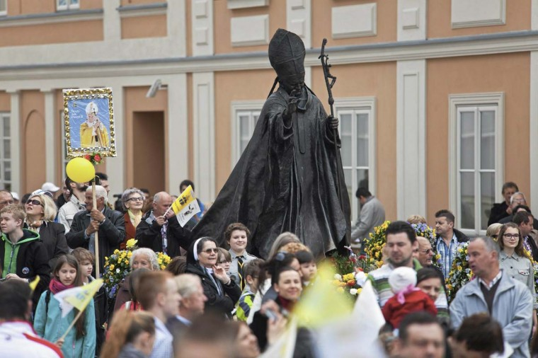 Catholic faithful celebrate the canonisation of Pope John XXIII and John Paul II in the hometown of Karol Wojtyla, who later become Pope John Paul II, in Wadowice April 27, 2014. Pope Francis proclaimed his predecessors John XXIII and John Paul II saints on Sunday, hailing both as courageous men who withstood the tragedies of the 20th century. (Michal Lepecki/Agencja Gazeta)