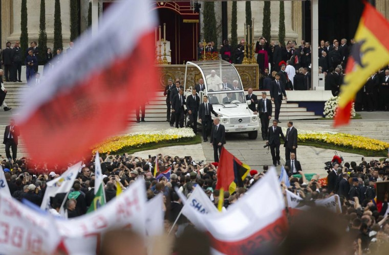 Pope Francis leaves on the Popemobile at the end of the canonisation ceremony of Popes John XXIII and Jean-Paul II at St. Peter's Square at the Vatican, April 27, 2014. Pope Francis proclaimed his predecessors John XXIII and John Paul II saints in front of more than half a million pilgrims on Sunday, hailing both as courageous men who withstood the tragedies of the 20th century. (Max Rossi/Reuters)