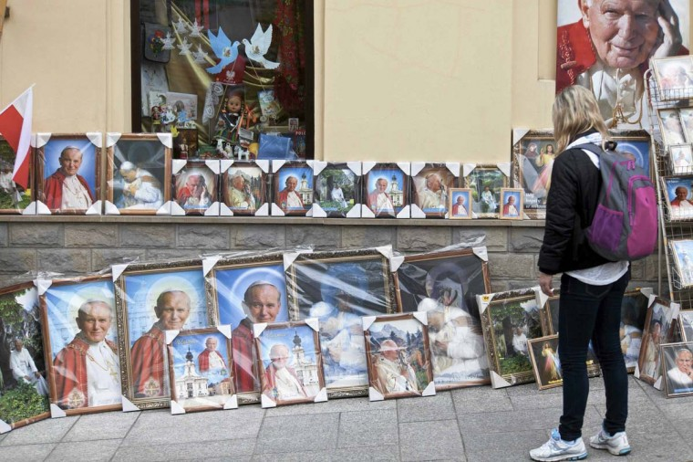 Pictures of Pope John Paul II are seen for sale during celebrations marking his canonisation along with his predecessor Pope John XXIII in the hometown of Karol Wojtyla, who later become Pope John Paul II, in Wadowice April 27, 2014. Pope Francis proclaimed his predecessors John XXIII and John Paul II saints on Sunday, hailing both as courageous men who withstood the tragedies of the 20th century. Souvenir shops in Poland do a brisk trade in papal memorabilia now that he is due to be declared a saint. In one store in a southern Polish city, a saleswoman says she has sold several thousand candles with an image of the late pope on them, at prices from 12 zlotys ($3.95) on up. (Michal Lepecki /Agencja Gazeta)
