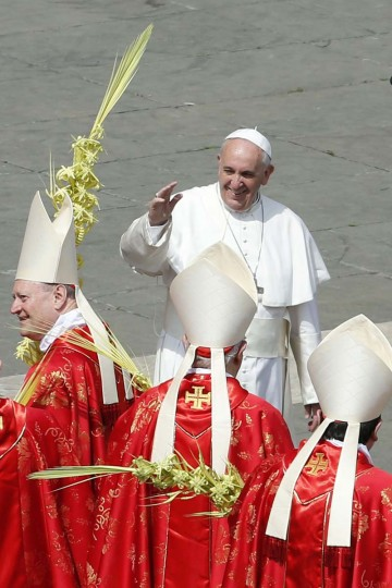 Pope Francis waves after leading the Palm Sunday mass at Saint Peter's Square in the Vatican April 13, 2014. (Giampiero Sposito/Reuters)