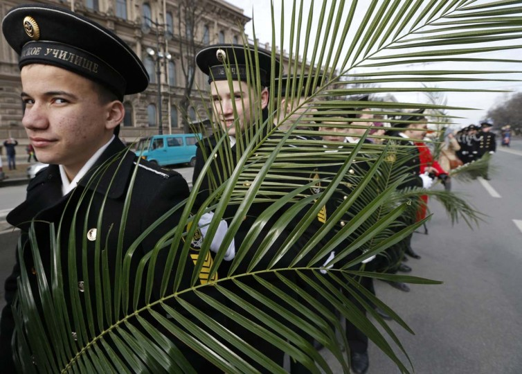 Cadets of the Nakhimov naval school hold palms during a religious procession to mark Palm Sunday in St. Petersburg
