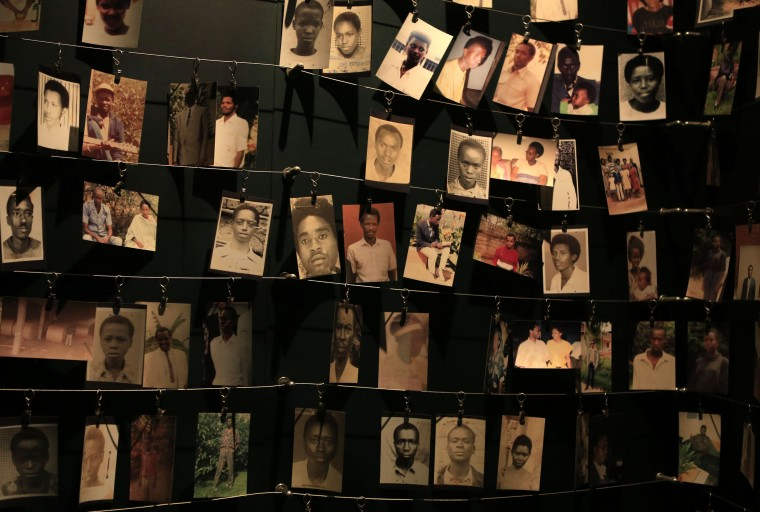 Photographs of people who were killed during the 1994 genocide are seen inside the Kigali Genocide Memorial Museum as the country prepares to commemorate the 20th anniversary of the genocide in the Rwandan capital Kigali April 5, 2014. An estimated 800,000 people were killed in 100 days during the genocide. (Noor Khamis/Reuters)