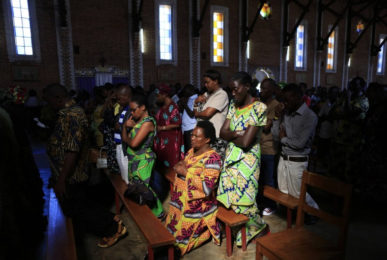 Worshippers attend a service at the Saint-Famille Catholic Church, one day ahead of the commemoration of the 20th anniversary of the genocide in the Rwandan capital Kigali April 6, 2014. An estimated 800,000 people were killed in 100 days during the genocide. (Noor Khamis/Reuters)