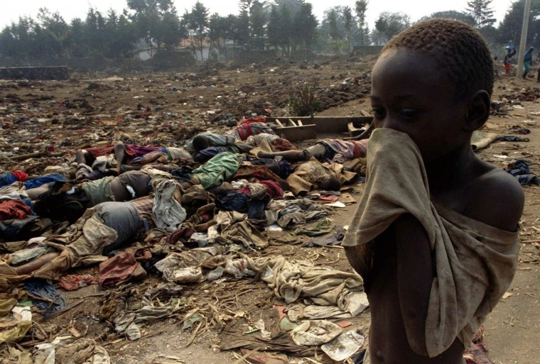 A Rwandan boy covers his face from the stench of dead bodies in this July 19, 1994 file photo. April 7, 2014 marks the 20th anniversary of the Rwanda genocide which killed 800,000 people. The three-month killing spree in 1994 by Hutu extremists targeted ethnic Tutsis, but moderate Hutus were also caught in the wave of violence that followed the fatal downing of a plane carrying Rwandan President Juvenal Habyarimana. (Corinne Dufka/Reuters)