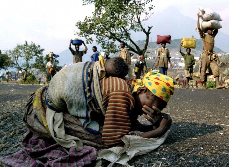 A Rwandan woman collapses with her baby on her back alongside the road connecting Kibumba refugee camp and Goma in this July 28, 1994 file photo. April 7, 2014 marks the 20th anniversary of the Rwanda genocide which killed 800,000 people. The three-month killing spree in 1994 by Hutu extremists targeted ethnic Tutsis, but moderate Hutus were also caught in the wave of violence that followed the fatal downing of a plane carrying Rwandan President Juvenal Habyarimana. (Ulli Michel)