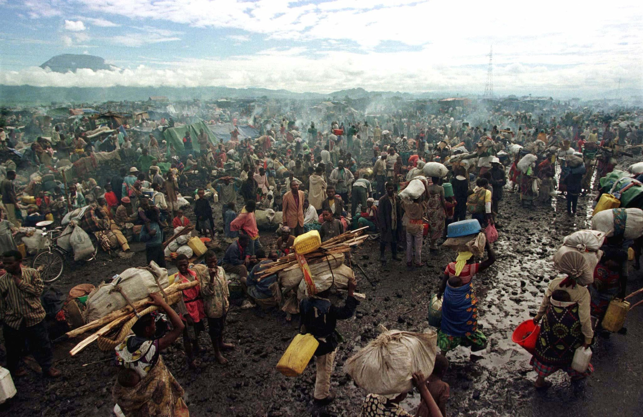 in memoriam 20 years since the rwandan genocide rwandan hutu refugees rest on the side of the road next to the old mugunga refugee camp near the border town of goma in this 16 1996 file photo