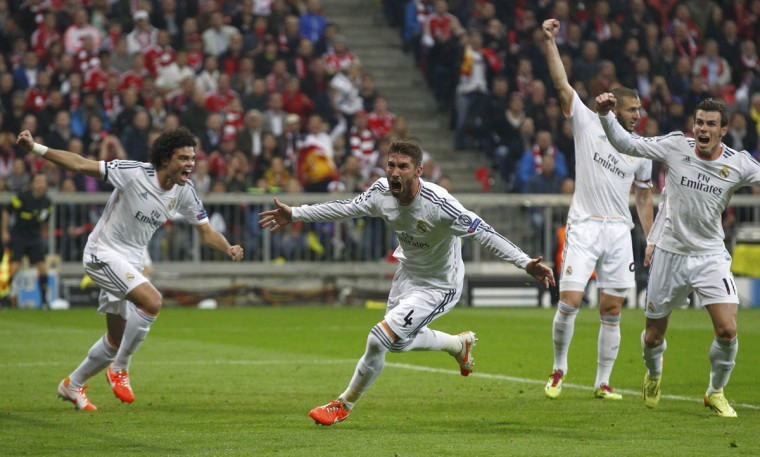 Real Madrid's Sergio Ramos (2nd L) celebrates his first goal against Bayern Munich in front of teammates Pepe (L), Karim Benzema (R) and Gareth Bale during their Champions League semi-final second leg soccer match in Munich April 29, 2014. (Michaela Rehle/Reuters)