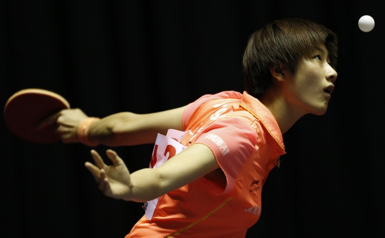 China's Ding Ning eyes the ball as she serves to Slovakia's Eva Odorova during the World Team Table Tennis Championships in Tokyo April 29, 2014. (Yuya Shino/Reuters)