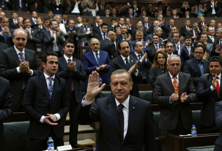 Turkey's Prime Minister Tayyip Erdogan greets members of parliament from his ruling AK Party (AKP) during a meeting at the Turkish parliament in Ankara April 8, 2014. Turkey's first directly elected president will be a more powerful figure than the current largely ceremonial role, Prime Minister Tayyip Erdogan was quoted on Tuesday as saying, boosting expectations he may run for the post in August. (REUTERS/Umit Bektas)
