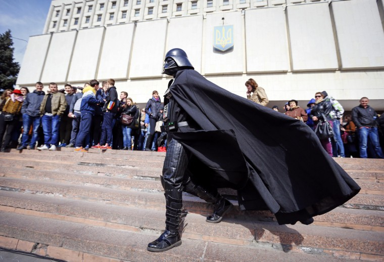 """Darth Vader"", the leader of the Internet Party of Ukraine, walks during a rally in front of the Ukrainian Central Elections Commission in Kiev April 3, 2014. ""Darth Vader"" has submitted documents to the Ukrainian Central Elections Commission to register as a candidate for Ukraine's May 25 presidential election. (Shamil Zhumatov/Reuters)"