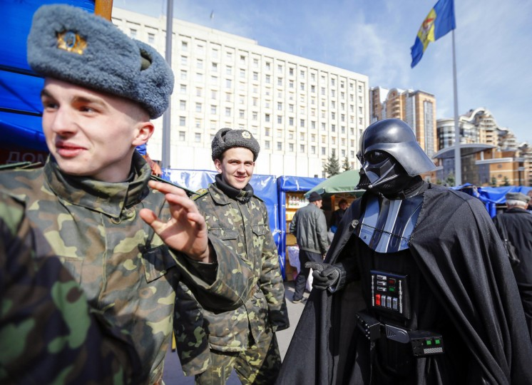 """Darth Vader"", the leader of the Internet Party of Ukraine, talks with cadets during a rally in front of the Ukrainian Central Elections Commission in Kiev. (Shamil Zhumatov/Reuters)"