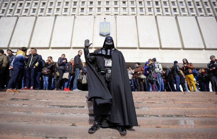 """Darth Vader"", the leader of the Internet Party of Ukraine, stands during a rally in front of the Ukrainian Central Elections Commission in Kiev. (Shamil Zhumatov/Reuters)"