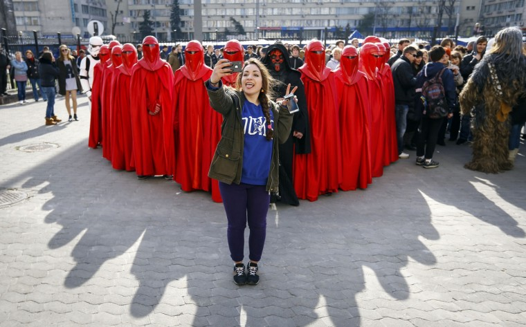 A woman takes a 'selfie' with a mobile phone in front of activists from the Internet Party of Ukraine during a rally near the Ukrainian Central Elections Commission in Kiev. (Shamil Zhumatov/Reuters)