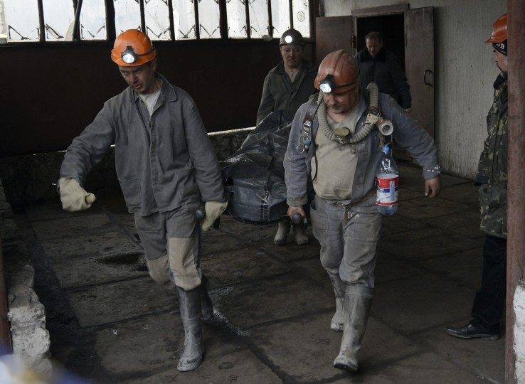 Men carry the body of a victim of an explosion on a stretcher at the Skochinsky mine outside Donetsk April 11. Seven people were killed on Friday when an explosion caused by leaking gas tore through a coal mine near the eastern Ukrainian city of Donetsk, local authorities said. Altogether 52 miners were working at a depth of 1,300 metres when the accident occurred at the Skochinsky mine. Apart from the seven killed, an eighth miner was taken to hospital with injuries.  || PHOTO CREDIT: MAKS LEVIN  - REUTERS