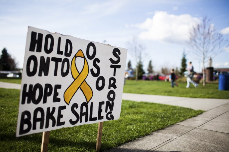 A sign directs people to a bake sale to benefit victims of the Oso, Washington mudslide in Arlington, Washington March 31, 2014. The official death toll rose to 24 on Monday - up from 21 a day earlier - with 30 people still listed as unaccounted for nine days after a rain-soaked hillside collapsed above the north fork of the Stillaguamish River, northeast of Seattle. (Max Whittaker/Reuters)