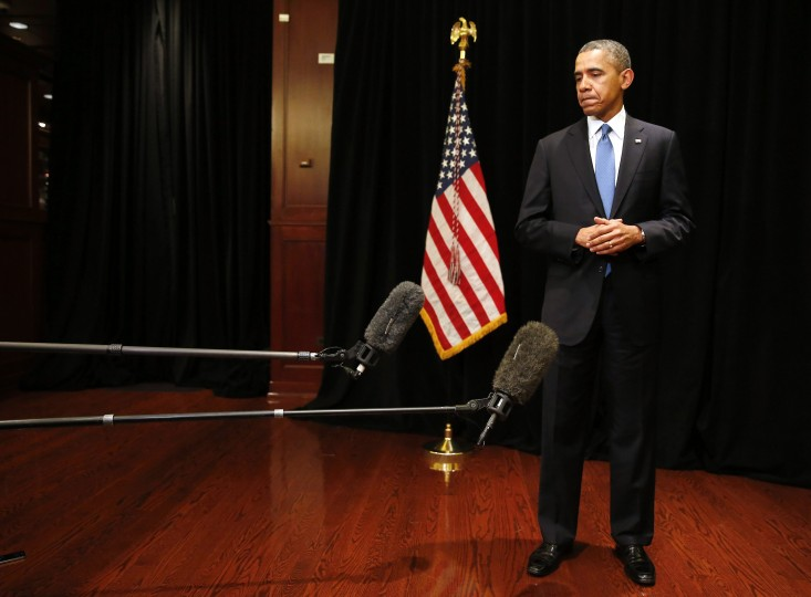 "U.S. President Barack Obama stands alone as he makes a statement about the shooting at Fort Hood in Texas, while in Chicago, April 2, 2014. Obama said on Wednesday he was ""heartbroken"" that another shooting had occurred at the Fort Hood Army base and described the situation there as fluid. At least one gunman opened fire on Wednesday, injuring an unknown number of people at the U.S. Army base in central Texas that was the scene of a shooting rampage in 2009, officials said. (REUTERS/Larry Downing)"