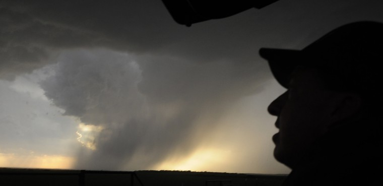 Storm chaser photographer Brad Mack watches thunderstorms supercells pass through areas in Kamay, Texas late April 23, 2014. The thunder storms on Wednesday were a precursor of what's forecast for this coming weekend Saturday, Sunday, and Monday that could be the most significant multi-day tornado outbreak in the U.S. since 2011. (Gene Blevins/Reuters)