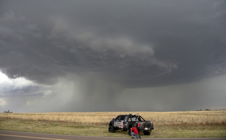 A storm chaser photographer looks at thunderstorms supercells pass through areas in Vinson, Oklahoma late April 23, 2014. The thunder storms on Wednesday were a precursor of what's forecast for this coming weekend Saturday, Sunday, and Monday that could be the most significant multi-day tornado outbreak in the U.S. since 2011. (Gene Blevins/Reuters)