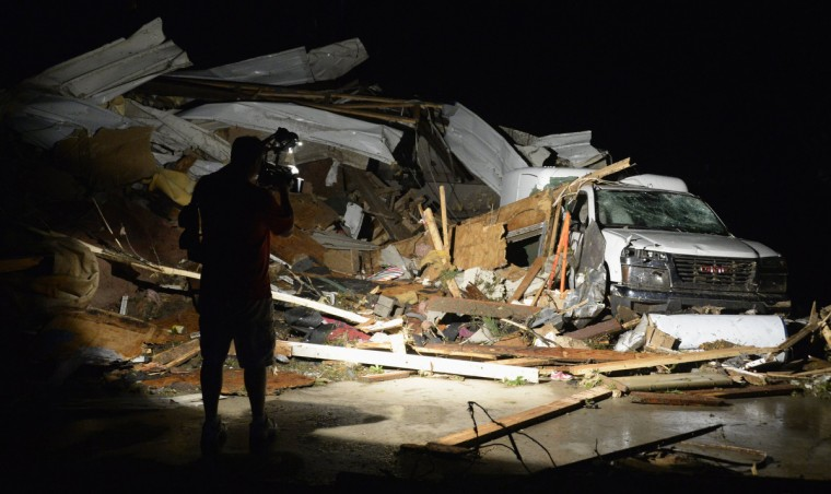 First In Video news video photographer Brad Mack covers the damage seen after a tornado hit the town of Mayflower, Arkansas around 7:30 pm CST, late April 27, 2014. Tornadoes ripped through the south-central United States on Sunday, killing at least 12 people in Arkansas and Oklahoma and wiping out entire neighborhoods of homes, according to officials, as rescue workers searched in darkness for survivors. In Mayflower, some of about 45 homes were destroyed in a newer subdivision and a lumberyard was damaged, said Will Elder, an alderman in the city of 2,300 people. (Gene Blevins/Reuters)