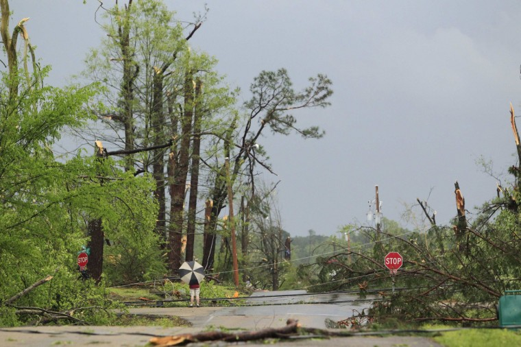 A lone resident surveys the damage following a Tornado that destroyed much the city in Tupelo, Mississippi April 28, 2014. On a second day of ferocious storms that have claimed at least 19 lives in the southern United States, a tornado tore through the Mississippi town of Tupelo on Monday causing widespread destruction to homes and businesses, according to witnesses and local emergency officials. (Thomas Wells/Reuters)
