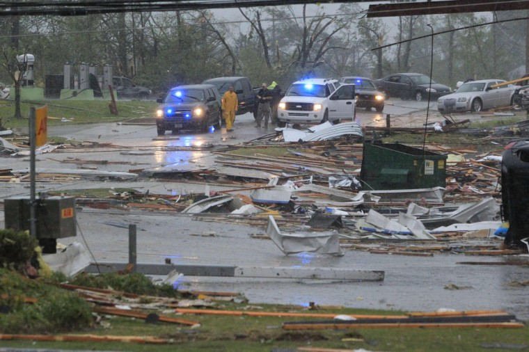 First responders begin to secure areas minutes after a Tornado tore through Tupelo, Mississippi April 28, 2014. On a second day of ferocious storms that have claimed at least 19 lives in the southern United States, a tornado tore through the Mississippi town of Tupelo on Monday causing widespread destruction to homes and businesses, according to witnesses and local emergency officials. (Thomas Wells/Reuters)