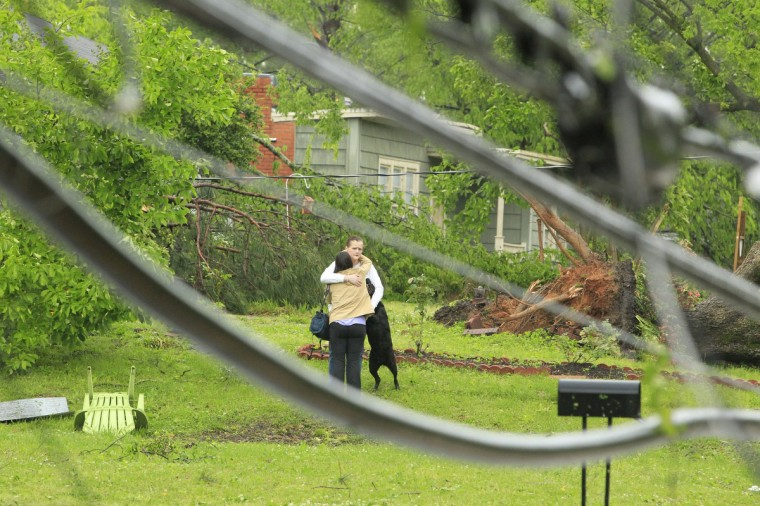 A homeowner gets hug of support from a neighbor after a Tornado destroyed her home on Jackson Street in Tupelo, Mississippi April 28, 2014. On a second day of ferocious storms that have claimed at least 19 lives in the southern United States, a tornado tore through the Mississippi town of Tupelo on Monday causing widespread destruction to homes and businesses, according to witnesses and local emergency officials. (Thomas Wells/Reuters)