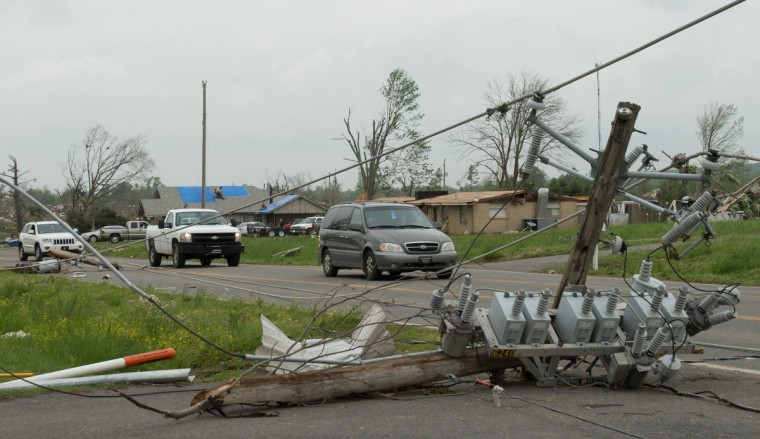 Traffic passes by a fallen electrical pole a day after a tornado hit the town of Vilonia, Arkansas April 28, 2014. Workers searched for survivors on Monday in the rubble left by a wave of tornadoes that ripped through the south-central United States a day earlier, killing at least 18 people in Arkansas, Oklahoma and Iowa. (Angie Davis/Reuters)