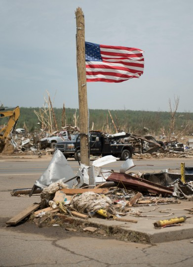 A U.S. flag flutters in the wind after being affixed to a pole a day after a tornado hit the town of Vilonia, Arkansas April 28, 2014. Workers searched for survivors on Monday in the rubble left by a wave of tornadoes that ripped through the south-central United States a day earlier, killing at least 18 people in Arkansas, Oklahoma and Iowa. (Angie Davis/Reuters)