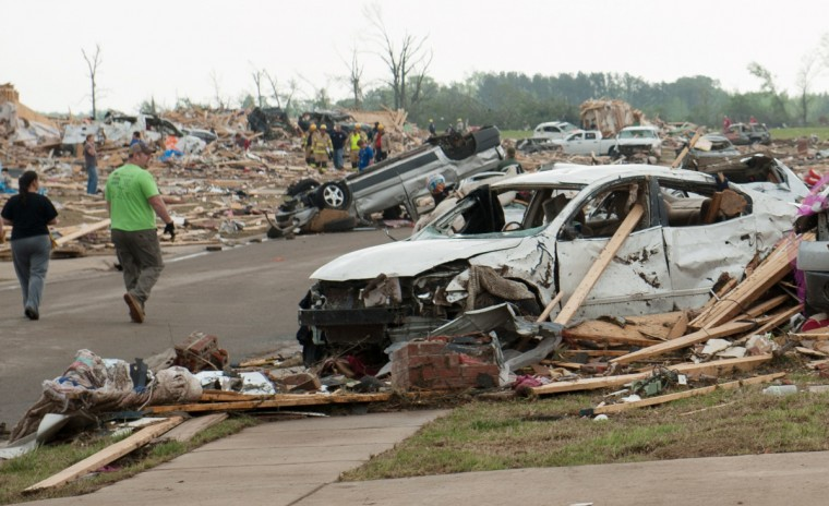 People search through the rubble of destroyed houses a day after a tornado hit the town of Vilonia, Arkansas April 28, 2014. Workers searched for survivors on Monday in the rubble left by a wave of tornadoes that ripped through the south-central United States a day earlier, killing at least 18 people in Arkansas, Oklahoma and Iowa. (Angie Davis/Reuters)