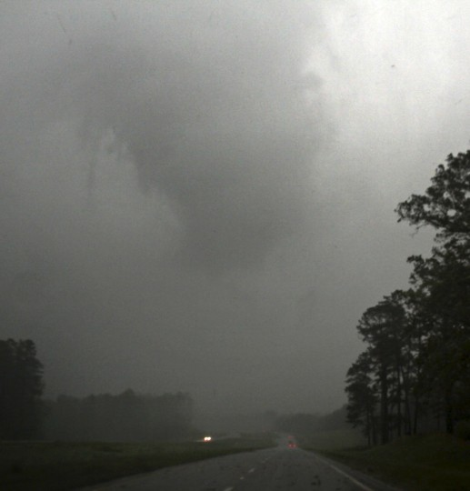 A large tornado is seen crossing the town of Louisville Mississippi April 28, 2014. On a second day of ferocious storms that have claimed at least 21 lives in the southern United States, a tornado tore through the Mississippi town of Tupelo on Monday destroying homes and businesses, according to witnesses and emergency officials. (Gene Blevins/Reuters)
