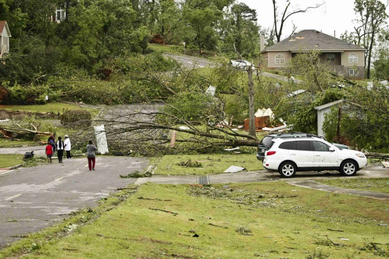 Fallen trees and damaged homes are seen after a tornado hit Bessemer April 29, 2014. At least 30 people across six states have been killed by a vicious storm system that unleashed dozens of tornadoes and was threatening to cause more damage in heavily populated regions of the U.S. South on Tuesday. (Marvin Gentry/Reuters)