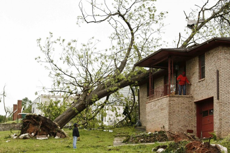 Fallen trees and damaged homes are shown in Bessemer, Alabama, April 29, 2014. At least 30 people across six states have been killed by a vicious storm system that unleashed dozens of tornadoes and was threatening to cause more damage in heavily populated regions of the U.S. South on Tuesday. (Marvin Gentry/Reuters)