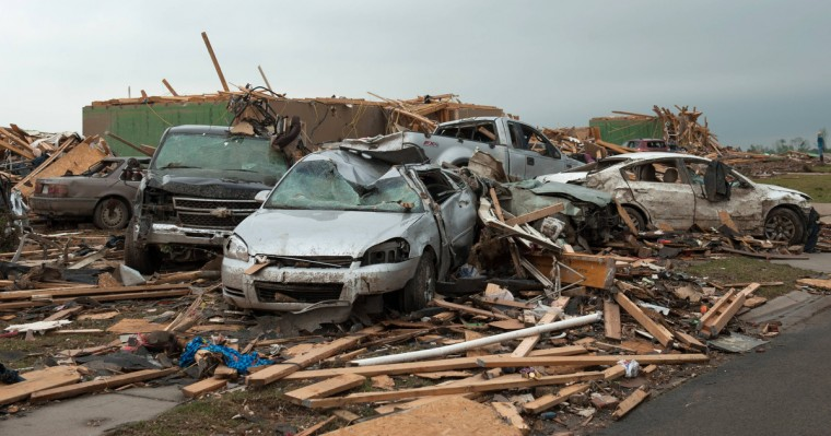 Destroyed cars are seen a day after a tornado hit the town of Vilonia, Arkansas April 28, 2014. Workers searched for survivors on Monday in the rubble left by a wave of tornadoes that ripped through the south-central United States a day earlier, killing at least 18 people in Arkansas, Oklahoma and Iowa. (Angie Davis/Reuters)