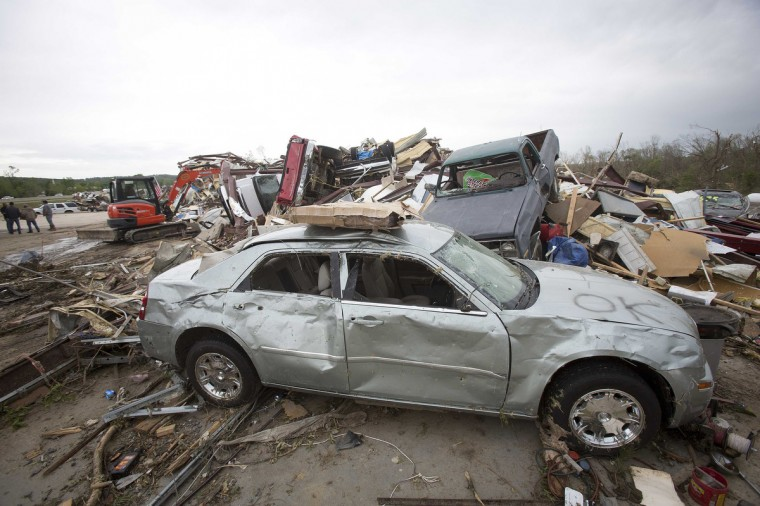 Cars and debris are pictured at Mayflower RV in Mayflower, Arkansas April 29, 2014. A storm system that killed more than 20 people continued its march across a large swath of the U.S. Southeast on Tuesday, packing baseball-sized hail, damaging winds and the threat of more tornados, meteorologists said. (Carlo Allegri/Reuters)